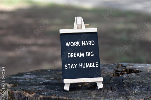 Foto  Inspirational quote - Work hard, dream big, stay humble, on black board