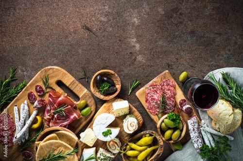 Fotografie, Obraz  Antipasto delicatessen - meat, cheese, olives and wine on stone
