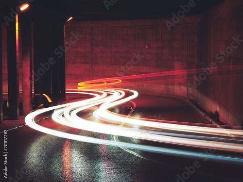 Foto op Aluminium Nacht snelweg Long exposure of the car lights under a bridge in Spain