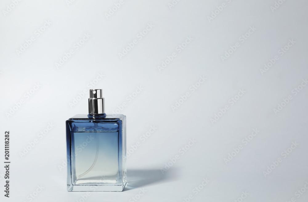 Fototapety, obrazy: Bottle of perfume on light background