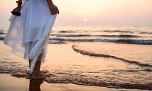 Girl Walking On The Beach Wear...