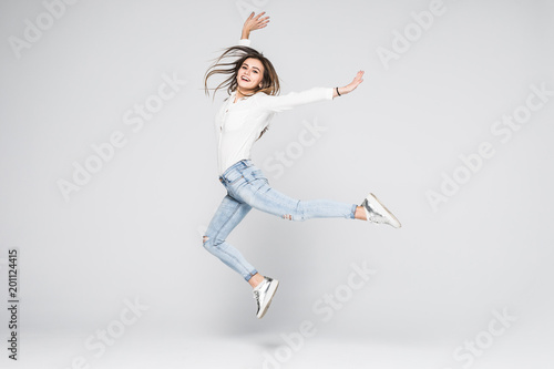 Papel de parede Full length portrait of a cheerful woman jumping isolated on a white background