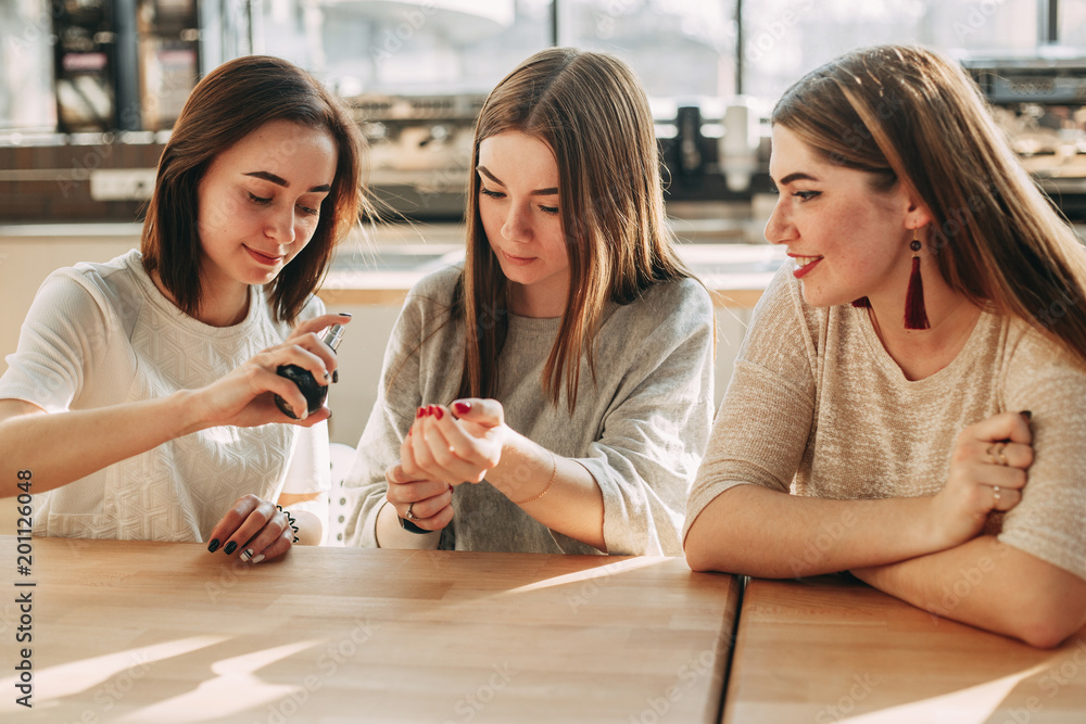 Fototapety, obrazy: Young woman testing new perfume