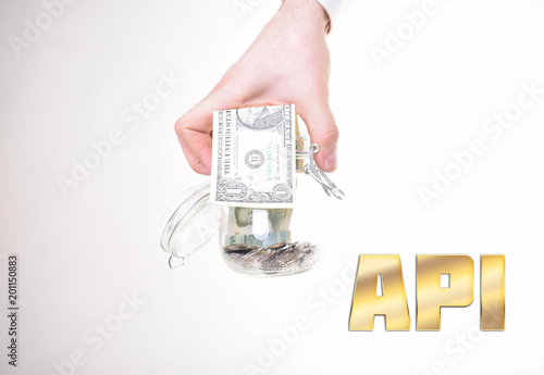 A Businessman With Bank Of Money Shows An Inscription Api
