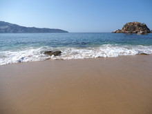 Scenery Of Rocks At Bay Of ACAPULCO City In Mexico, Pacific Ocean Waves On Sandy Beach Landscape