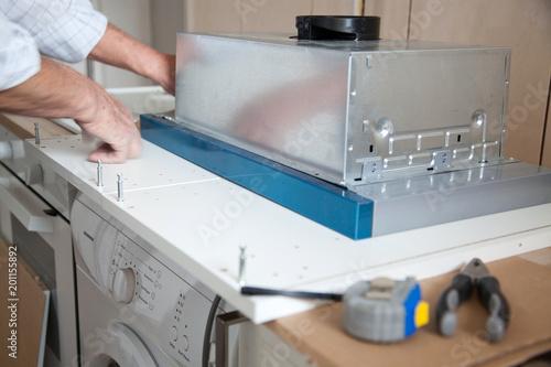Poster Individuel man installing kitchen - DIY concept