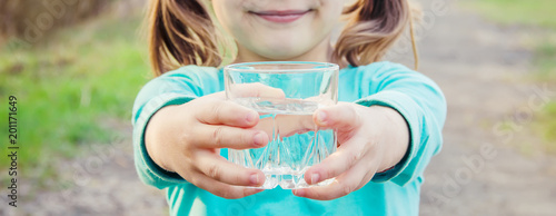 child glass of water. selective focus.