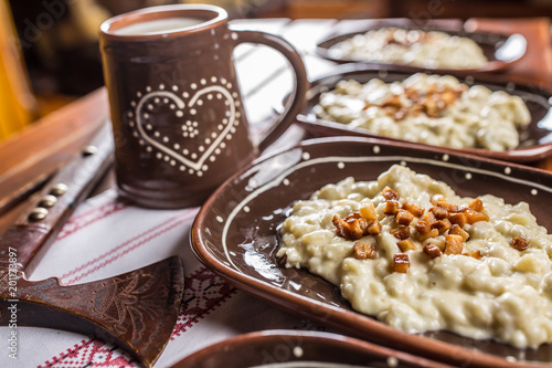 Traditional slovakian food Halusky with fried bacon and decoration