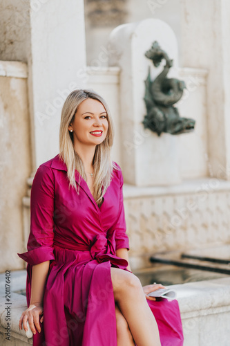 Poster  Outdoor portrait of beautiful woman wearing pink dress