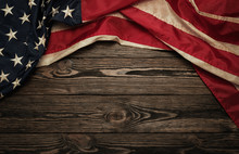 Old USA Flag On Wooden Backgro...