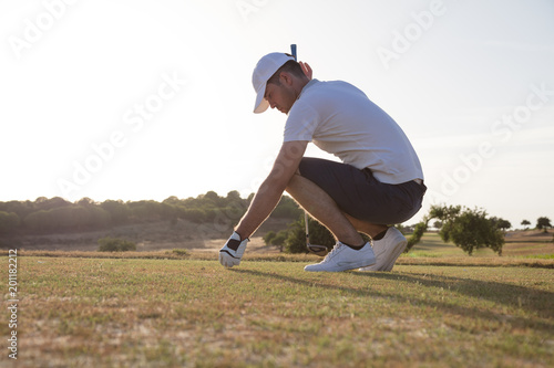 Golfer preparing for tee off