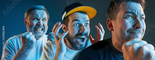 Fotografie, Obraz  The emotional angry men screaming on blue studio background