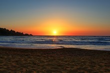 Beautiful Sunset On A Secluded Mediterranean Sandy Beach In Malta