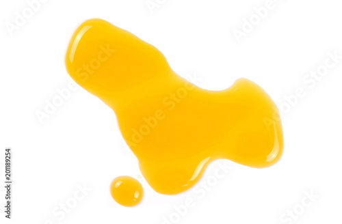 Puddle of orange juice isolated on white background, clipping path, top view