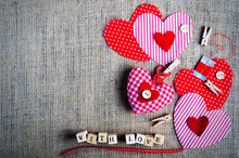 Red Polka Dot Textile Hearts On Burlap. Free Space For Your Text.