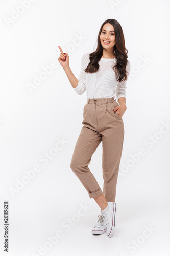 Full length portrait of a smiling asian businesswoman Wall mural