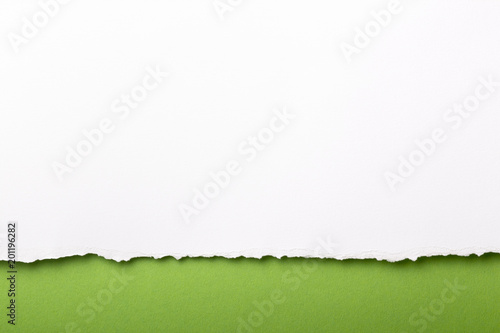 Fotografia, Obraz Ripped white paper with colored background with space for text
