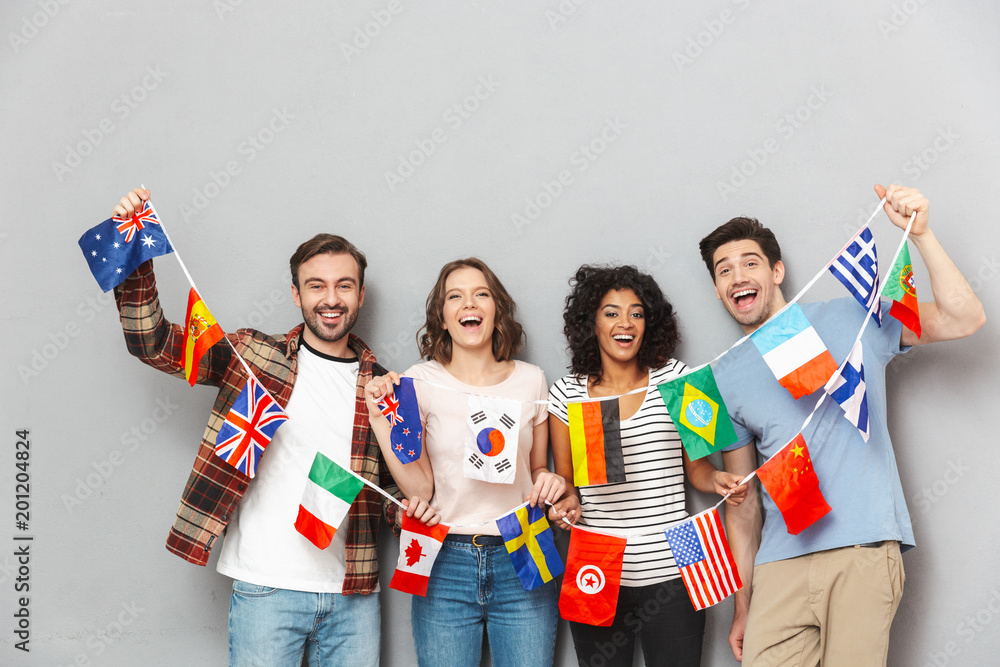 Fototapety, obrazy: Happy group of friends holding a lot of international flags.