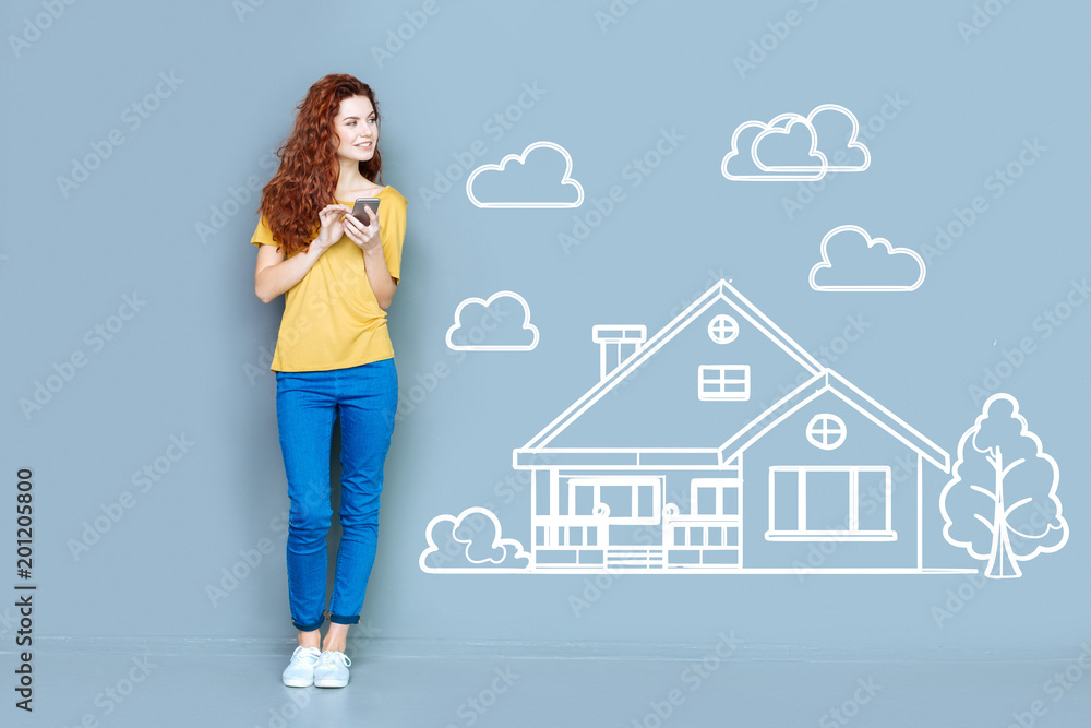 Fototapety, obrazy: Buying a house. Cheerful optimistic young woman feeling good while thinking about buying a new beautiful house