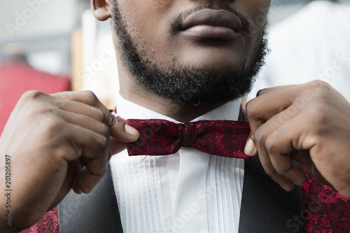Detail of black man accommodating the bow tie