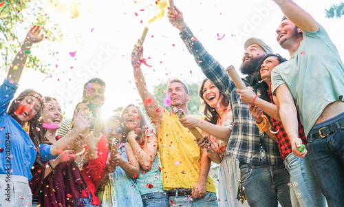 canvas print motiv - DisobeyArt : Happy friends having party,throwing confetti and using smoke bombs colors outdoor