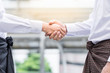 Portrait image Close up of Two asian Myanmar (formerly Burma) confident business man shaking hands during meeting outside the office Partner business concept