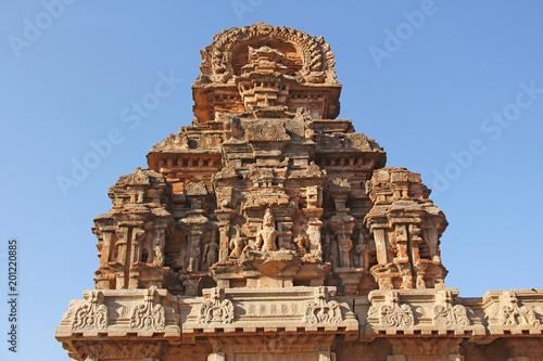 Hazara Rama Temple in Hampi, Karnataka, India. Unesco World Heritage Site. Carving stone ancient background. Fragment of red brick terracotta. Beige ancient antique background