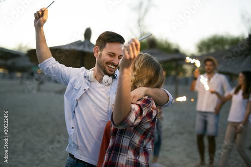 Fotografija  Group of happy young people enjoying summer vacation