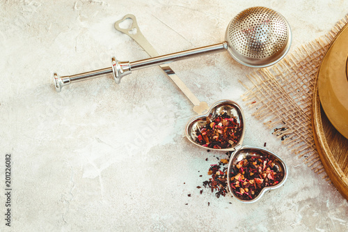 Fényképezés  Metal tea infuser with leaves