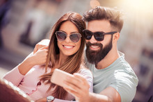 Smiling Couple Taking Selfie