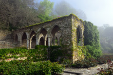 An Old Stone Building And A Ga...