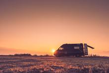 Camper Car On Nature At Sunrise