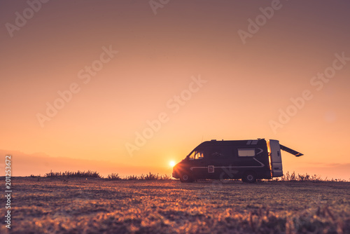 Canvas-taulu Camper car on nature at sunrise