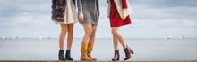 Three Women Presenting Shoes O...