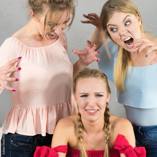 Woman being bullied by two females #201258067