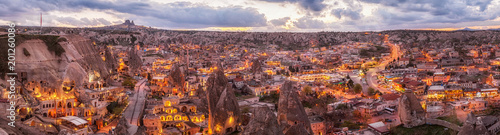 Poster Turquie panoramic night view of Goreme and Uchisar on horizon, Cappadocia, Turkey. A world-famous tourist center of balloon flight