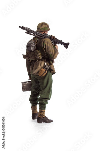 Leinwand Poster Man actor in the movie role of an old military man  with a MG 42 machine gun pos
