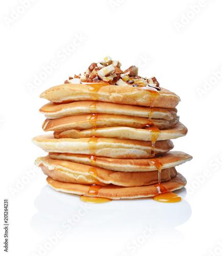 Tasty breakfast. Homemade pancakes with crushed hazelnut, honey or maple syrup