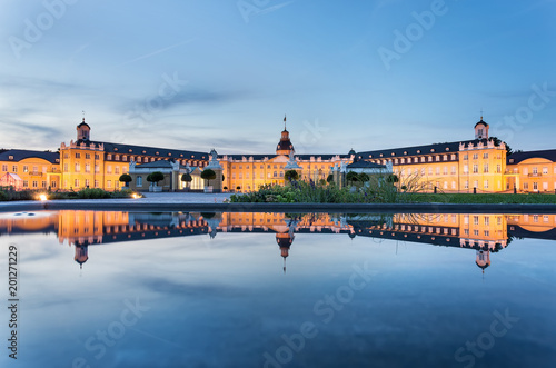 Staande foto Historisch geb. Karlsruhe castle reflected in water in summer evening