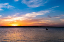 Fishing On The Lake At Sunset.