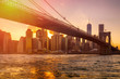 Sunset in New York with a view of the Brooklyn Bridge and Lower Manhattan