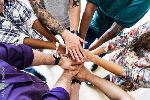 Fototapety, obrazy: Group of diverse people joined hands together teamwork