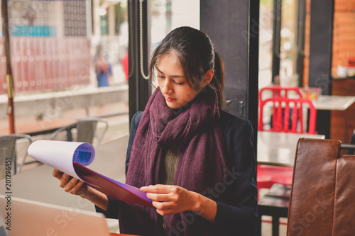 Business Concept Young Asian businesswoman is working
