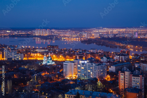 Foto op Canvas Seoel Aerial view of night Voronezh downtown. Voronezh cityscape at blue hour. Houses, churches and Voronezh river from high rooftop