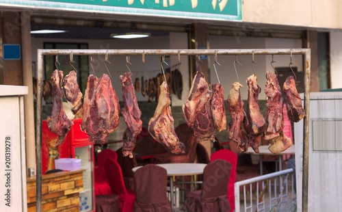 Meat for slaughter hanging on the street (Kunming, Yunnan, China) Canvas Print