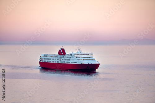 Fotografia, Obraz Sunset and a blue white ferry boat in greek islands