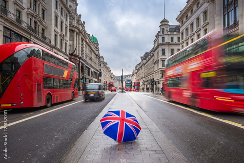Fotografía London, England - British umbrella at busy Regent Street with iconic red double-