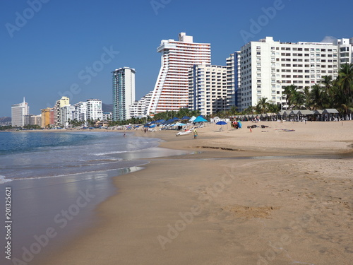 Fotografija  Panorama of white hotel buildings on beauty sandy beach at bay of Pacific Ocean
