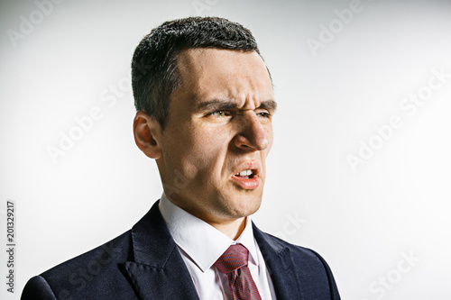 Fotografie, Tablou  Three-quarter portrait of a businessman with disgust face