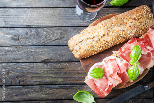 Staande foto Snack Sandwich with jamon serrano and basil